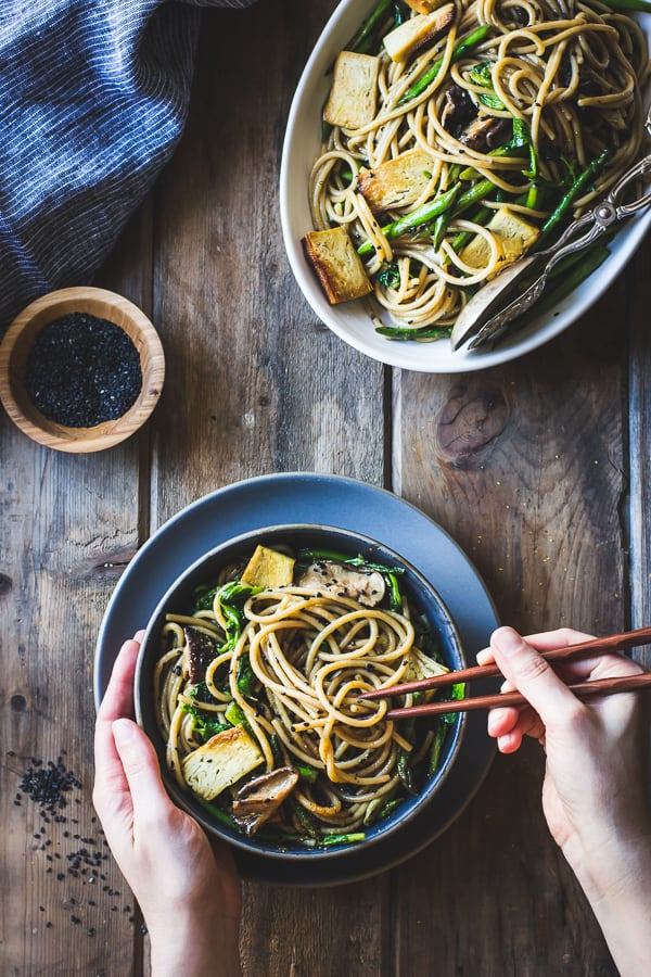 bowl of Hot Sesame Rice Noodles with Asparagus, Shiitakes and Pea Shoots