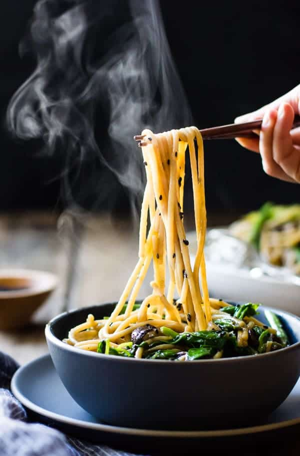 Hot Sesame Rice Noodles with Asparagus, Shiitakes and Pea Shoot in a bowl