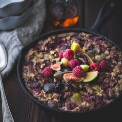 Baked Rolled Barley with Figs, Berries, and Cardamom in a skillet