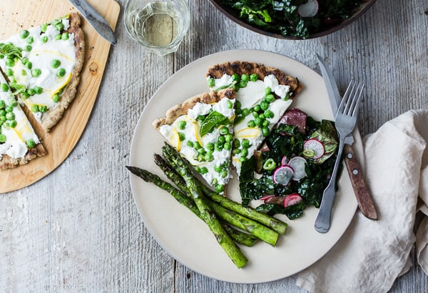 slices of Grilled Gluten-Free Pizza with Peas, Lemon + Mint