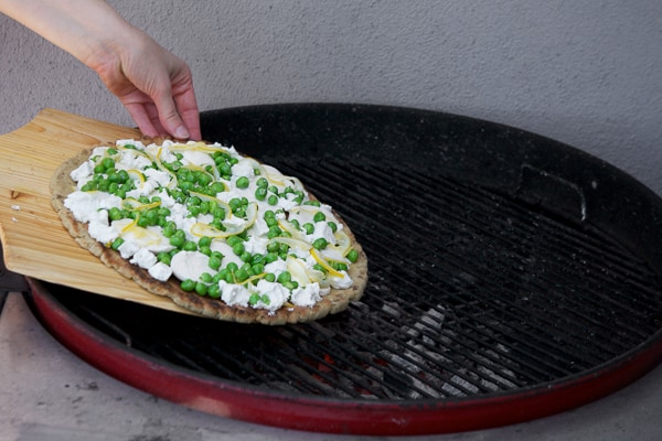 pizza placed on grill