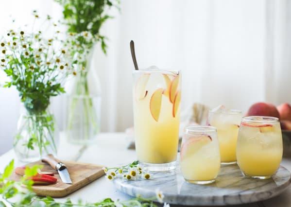 glasses of White Nectarine Prosecco Sangría with Ginger & Elderflower