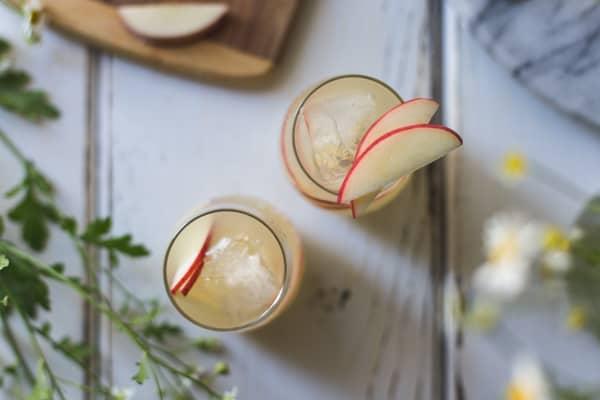 top down shot of White Nectarine Prosecco Sangría with Ginger & Elderflower