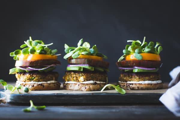 Spiced Zucchini, Feta + Chickpea Veggie Burgers with Minted Yogurt Sauce without top buns