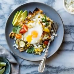Baked Green Chilaquiles with Sweet Corn + Summer Squash on a plate