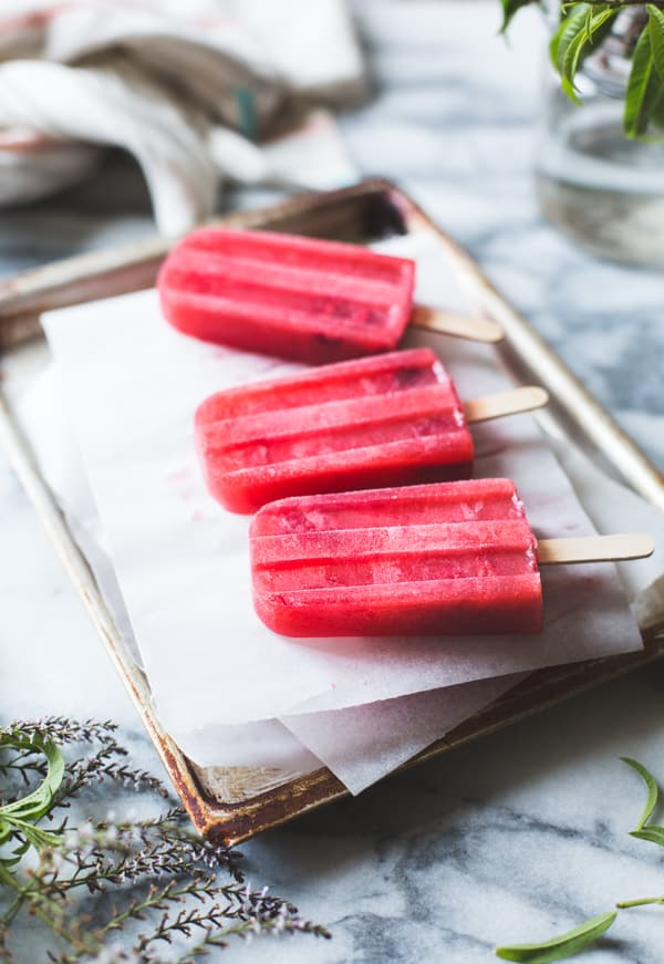 row of Raspberry, Lillet + Lemon Verbena Popsicles