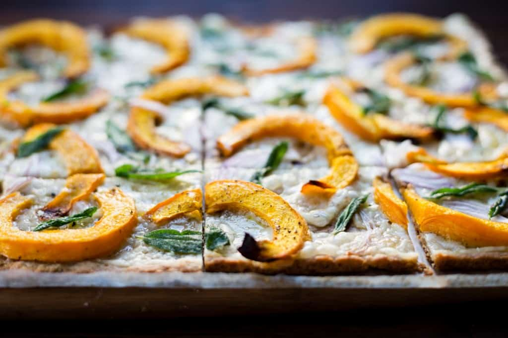 side shot of Pumpkin Flatbread with Gruyere and Crispy Sage {gluten-free}
