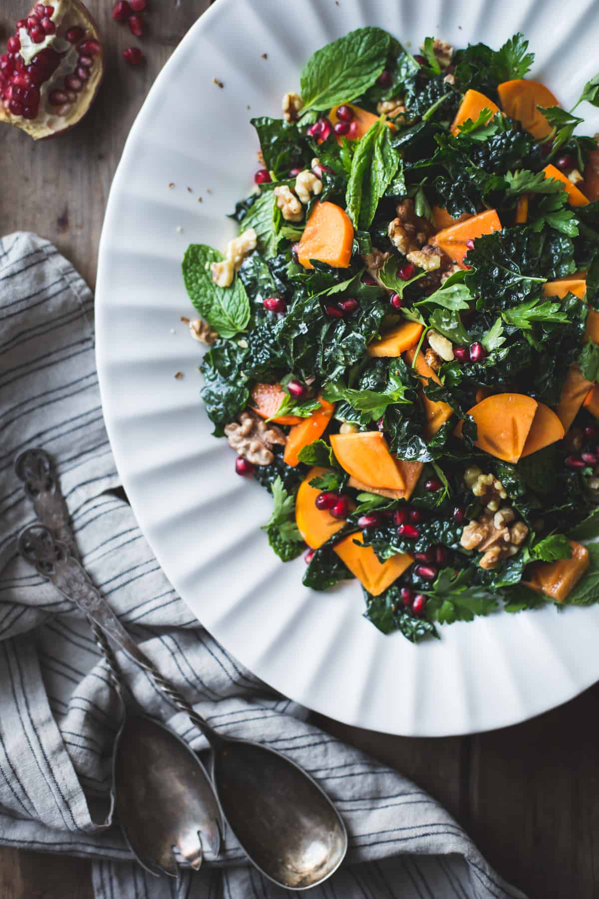 Herbed Kale Salad with Persimmon, Pomegranate and Maple-Cumin Dressing