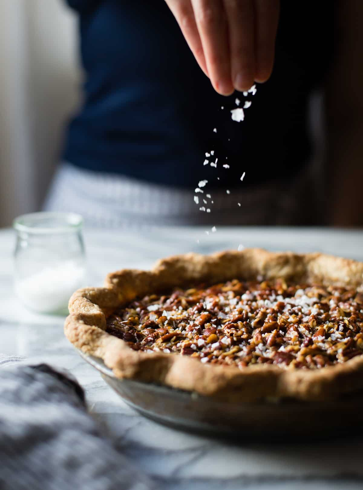 side shot of Bourbon Sorghum Pecan Pie {with a gluten-free sorghum crust}