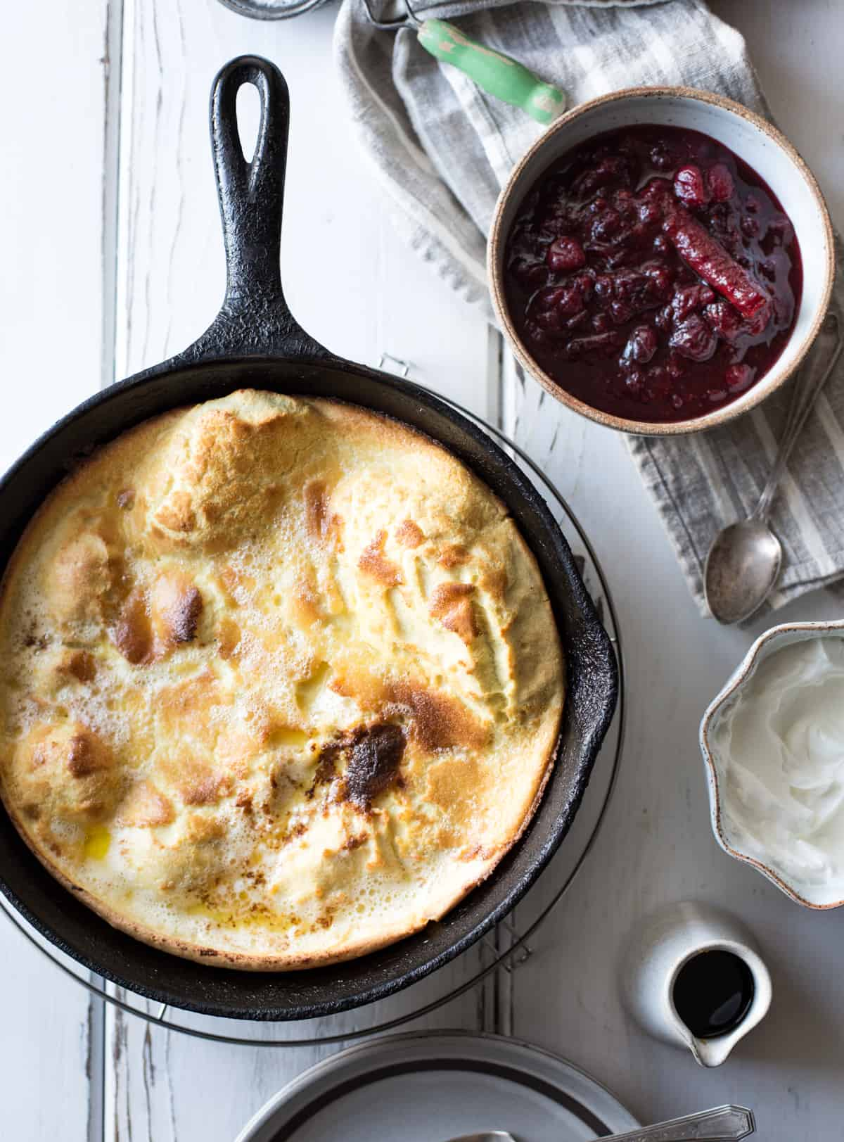 Gluten-Free Sorghum Buttermilk Dutch Baby, Maple Cranberry Sauce in skillet