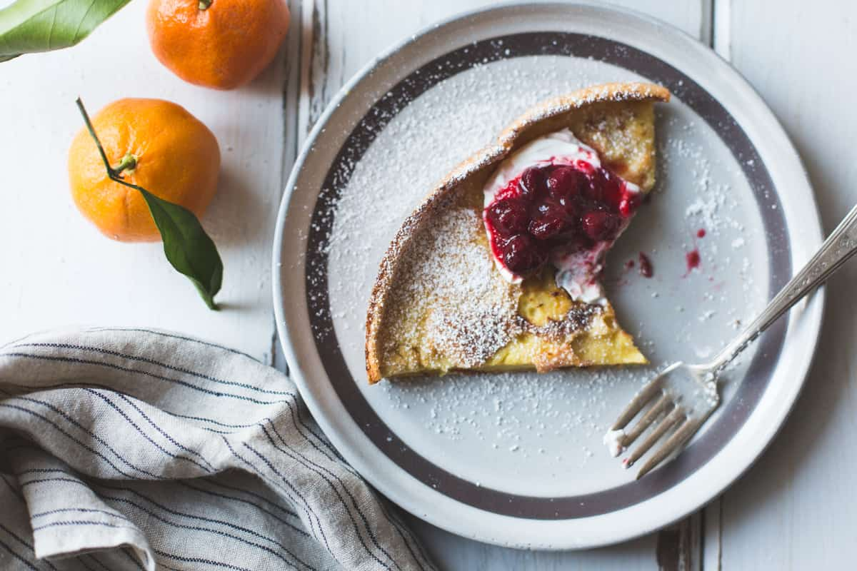 slice of Gluten-Free Sorghum Buttermilk Dutch Baby, Maple Cranberry Sauce