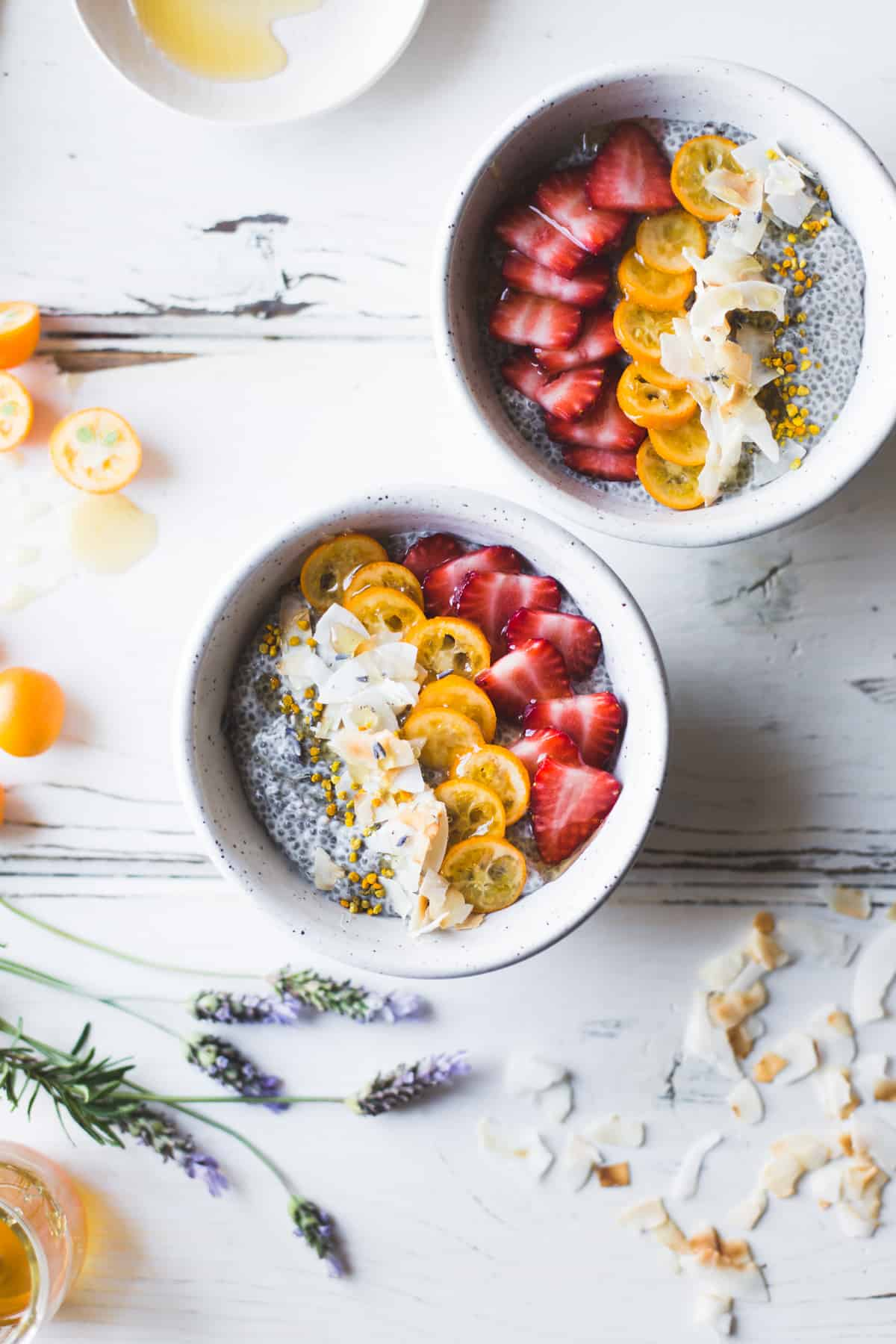 2 bowls of Chia Pudding Breakfast Bowls with Kumquats, Berries & Lavender Honey {gluten-free, dairy-free}