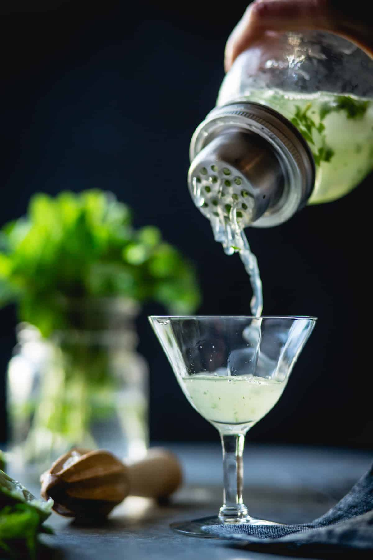 pouring a glass of Verdant Lady {Chartreuse, Gin & Mint Cocktail}
