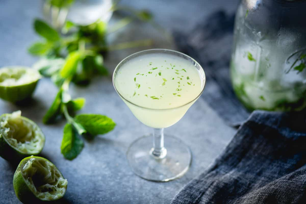 stemmed glass of Verdant Lady {Chartreuse, Gin & Mint Cocktail}