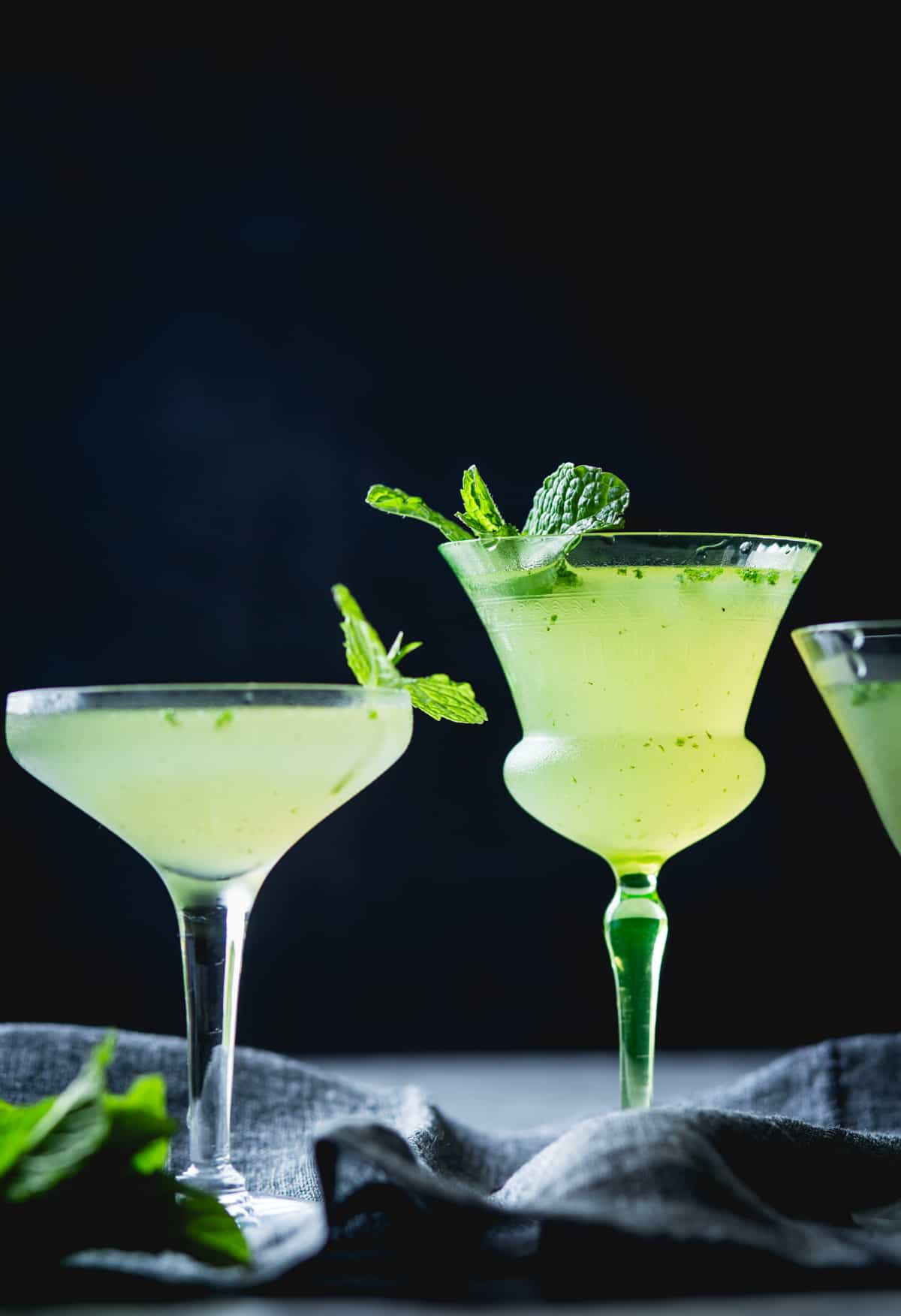 tall stemmed glasses of Verdant Lady {Chartreuse, Gin & Mint Cocktail}