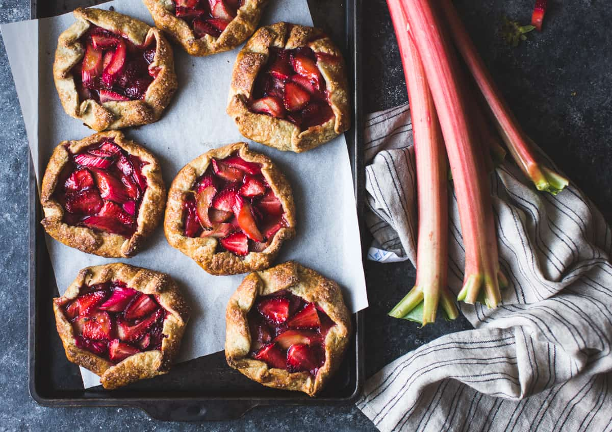 Strawberry Rhubarb Galettes on a baking sheet