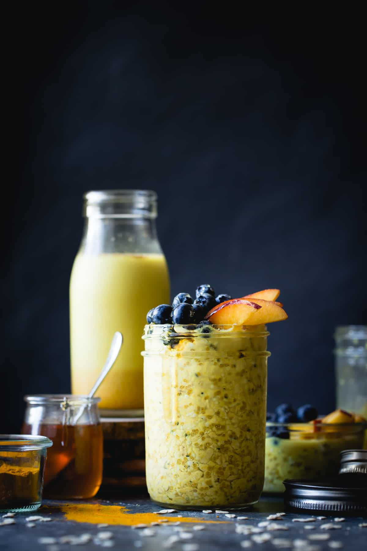 tall jar of Golden Milk Overnight Oats with Turmeric, Spices, and Honey {gluten-free, vegan}