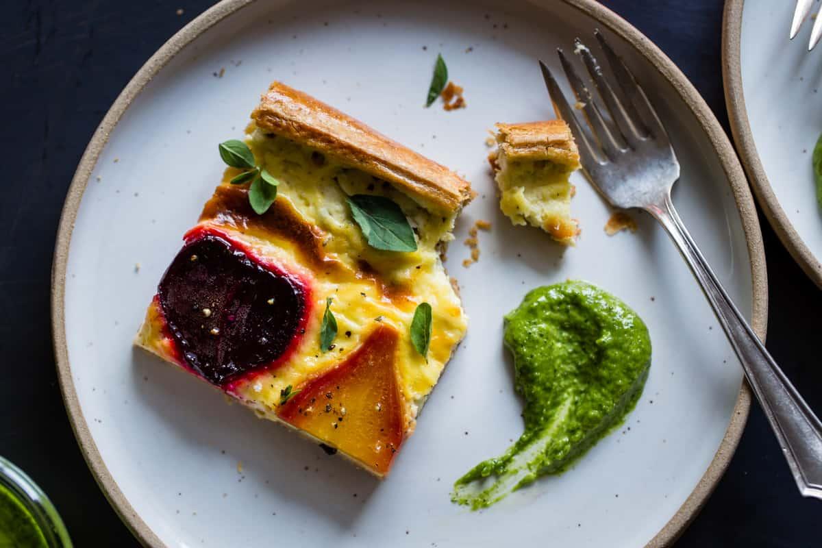 slice of Ricotta Beet Tart with Beet Green Pesto