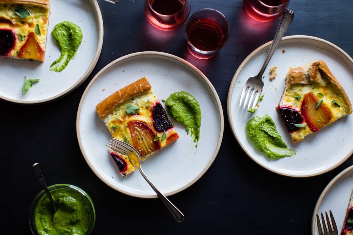 3 plates of Ricotta Beet Tart with Beet Green Pesto