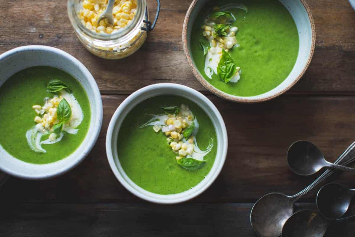 Zucchini Basil Soup with Crème Fraîche and Pickled Corn