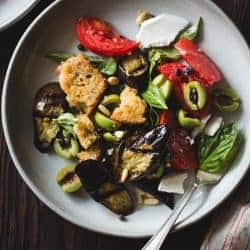 Roasted Eggplant Panzanella with Capers, Olives, and Pine Nuts