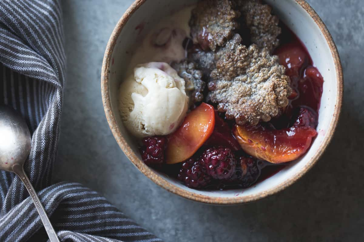 bowl of Blackberry Peach Buckwheat Pandowdy + Toasted Buckwheat Ice Cream {gluten-free}