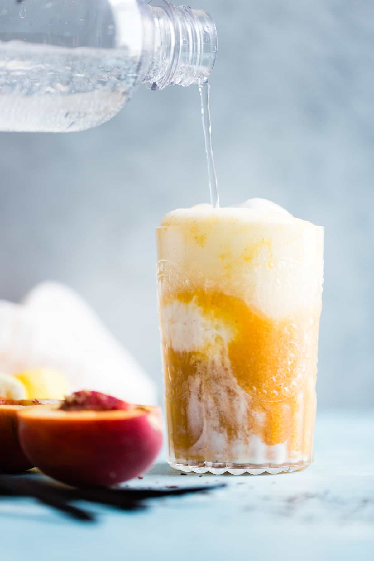 pouring soda into Vanilla Rooibos Peach Ice Cream Floats {vegan}