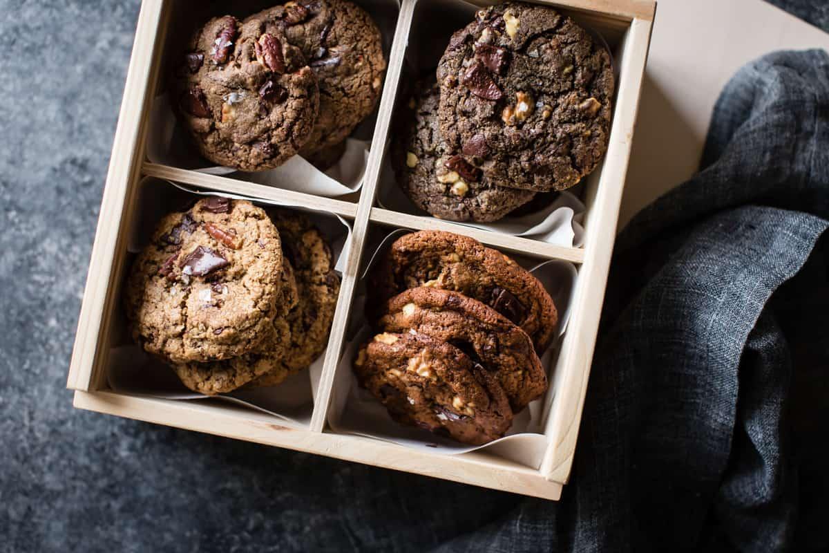 wooden box of Gluten-Free Chocolate Chip Cookies Four Ways: Oat, Teff, Buckwheat, Mesquite