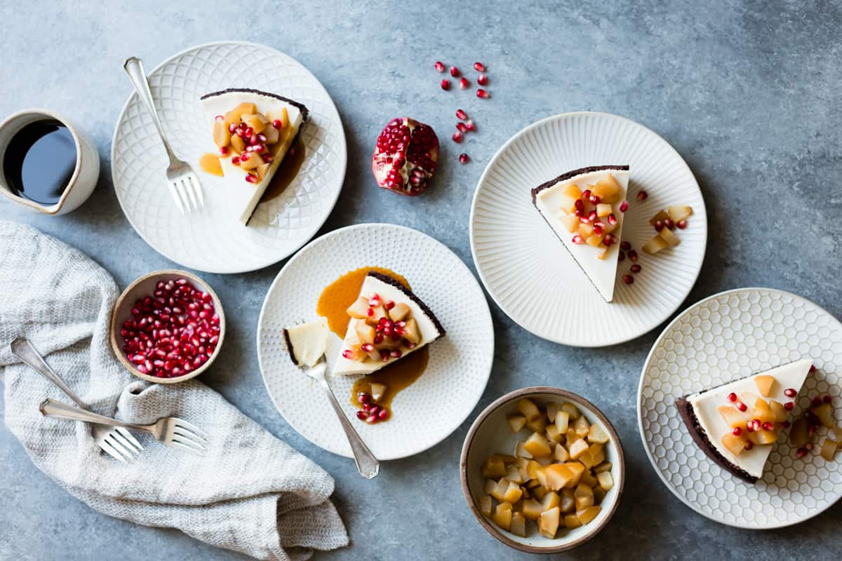 4 slices of Chocolate Crusted Chèvre Cheesecake with Earl Grey Poached Pears & Pomegranate {gluten-free}