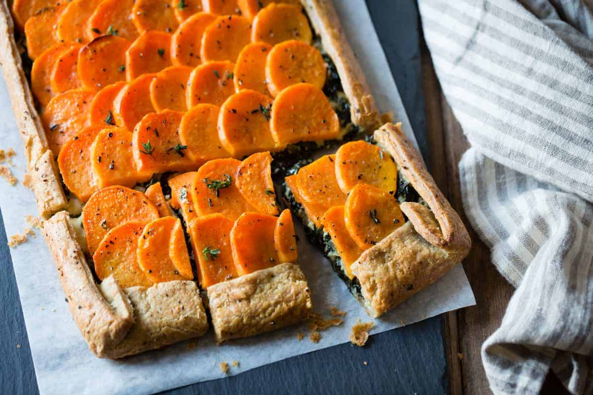Cheesy Sweet Potato Kale Galette {gluten-free, whole-grain} on parchment