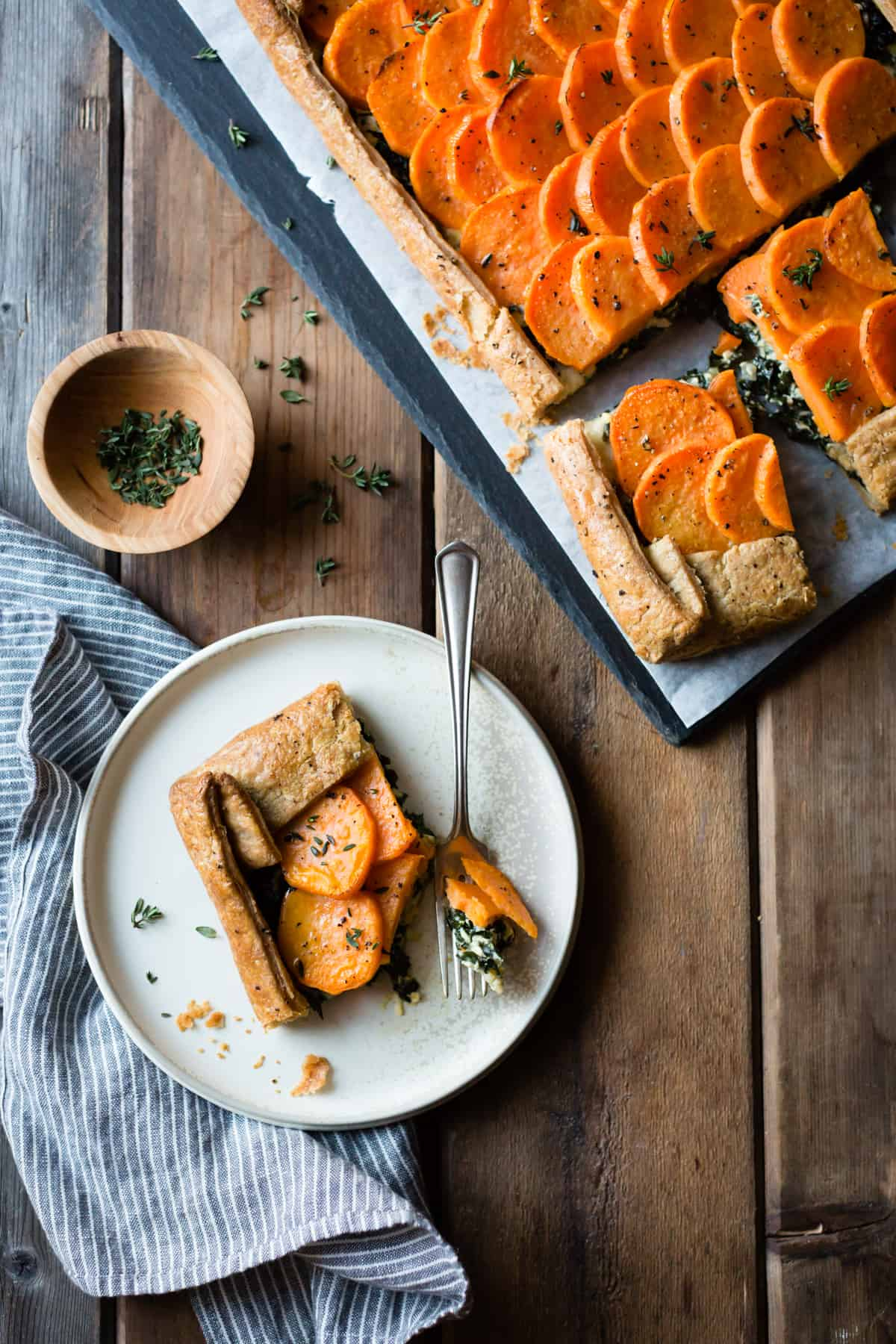 slice of Cheesy Sweet Potato Kale Galette {gluten-free, whole-grain} on plate