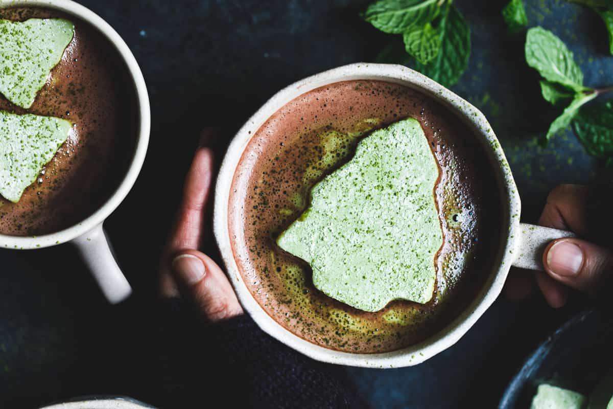 hands holding mug of Fresh Mint Hot Cocoa with Matcha Marshmallows