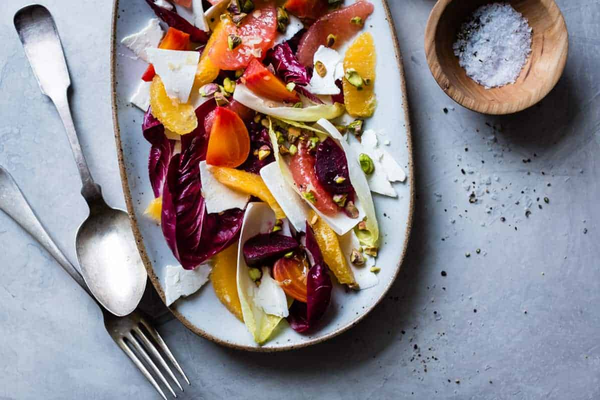 Beet, Citrus, & Chicory Salad with Ricotta Salata and Pistachios and bowl of salt