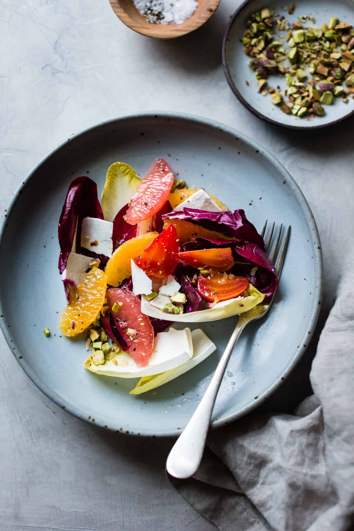 plate of Beet, Citrus, & Chicory Salad with Ricotta Salata and Pistachios