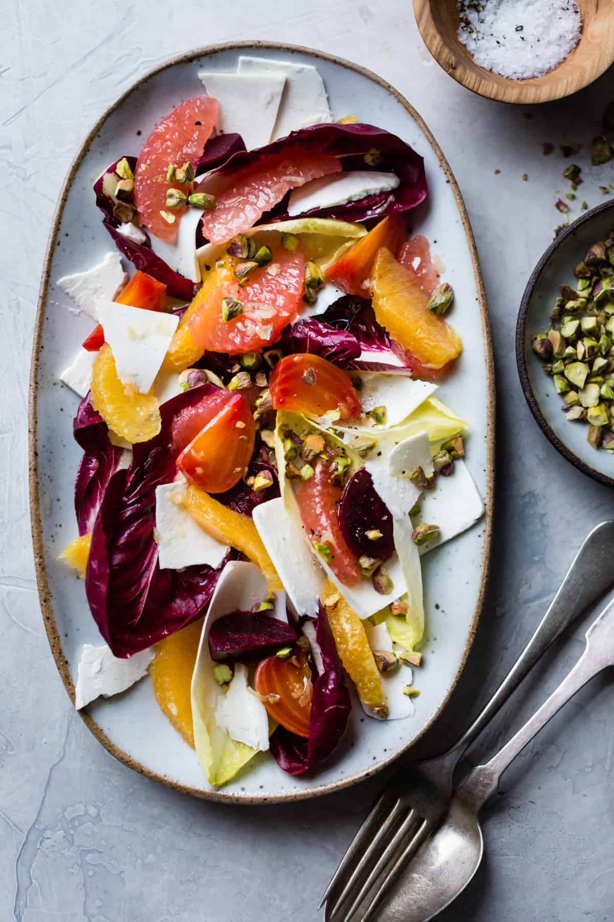 overhead shot of Beet, Citrus, & Chicory Salad with Ricotta Salata and Pistachios