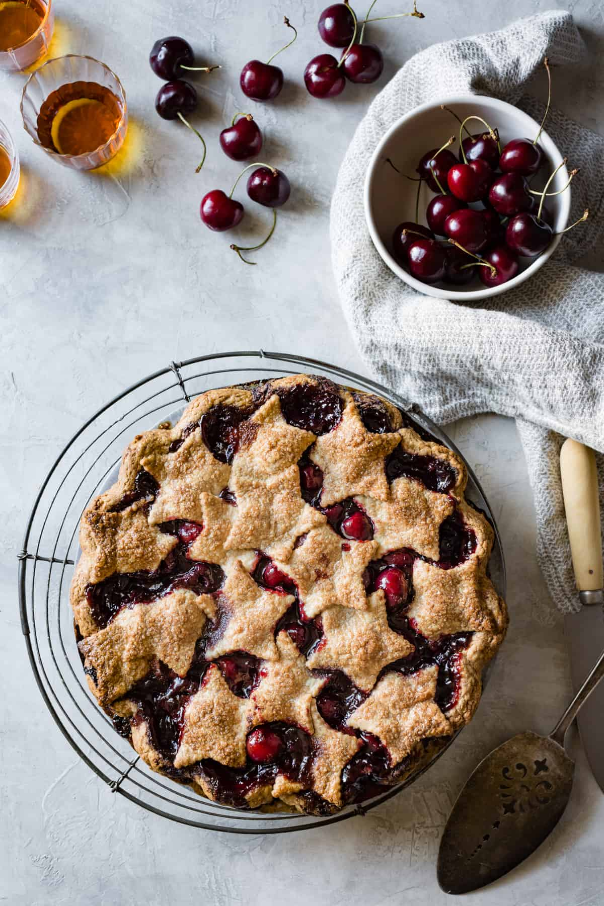 Spiced Bourbon Cherry Pie {gluten-free} with bowl of cherries