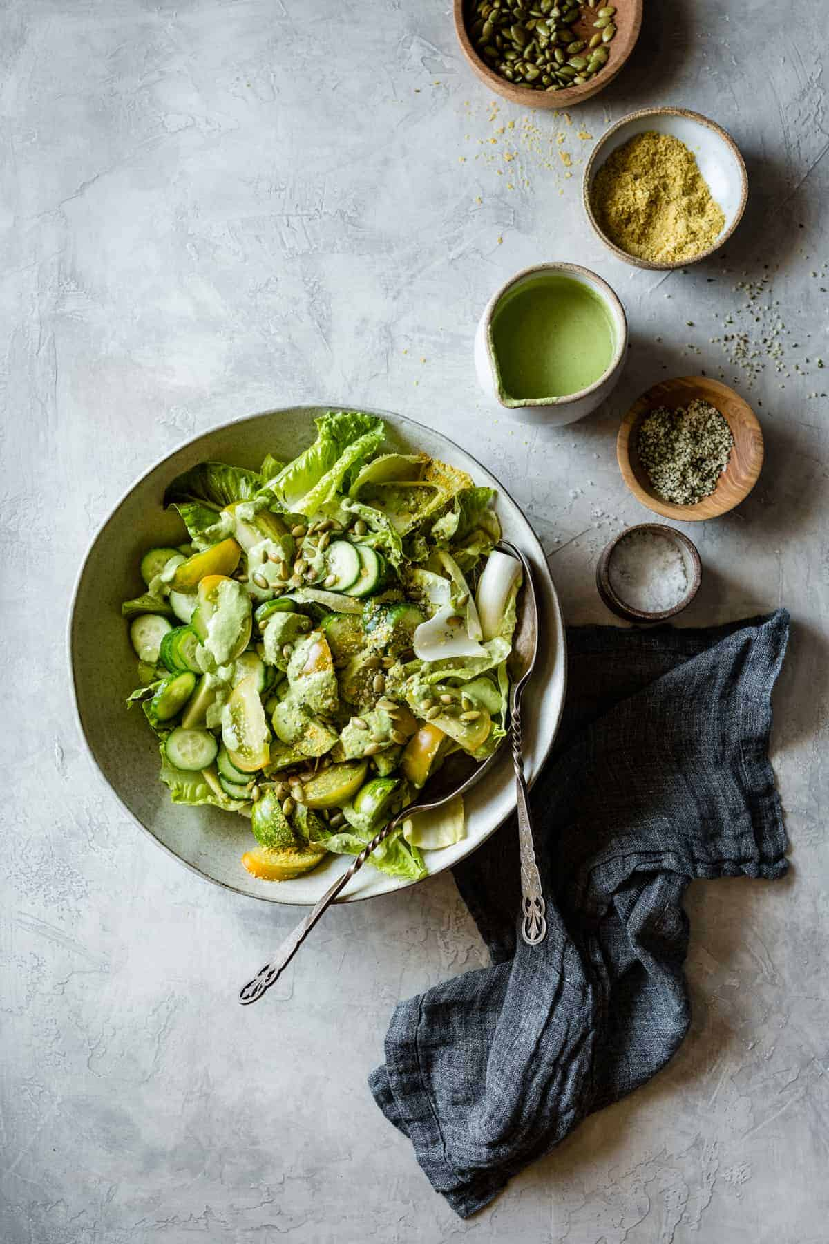 delicious creamy cashew green goddess dressing on a salad