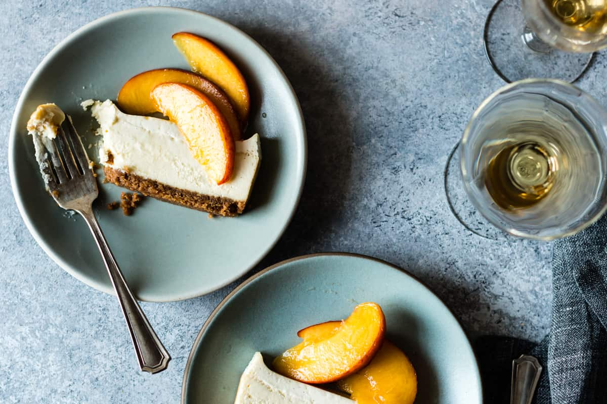 two slices of Small Batch Cheesecake with Elderflower Peaches