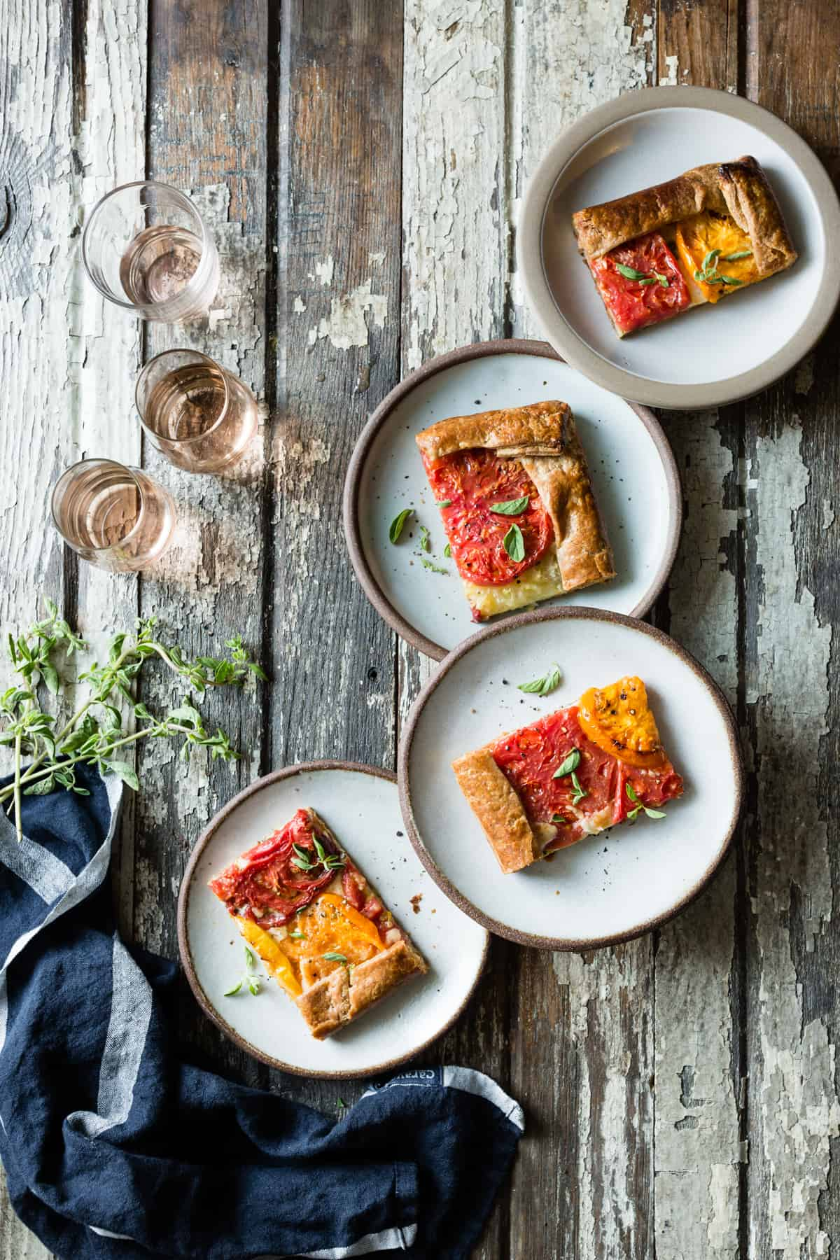 four plates of Rustic Heirloom Tomato Tart {gluten-free}