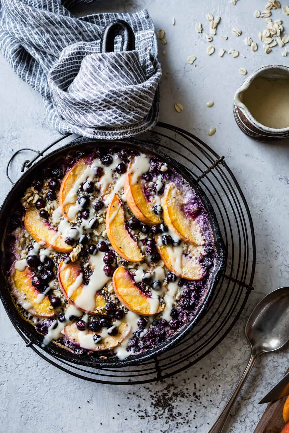 hearty and delicious Super Seedy Vegan Baked Oatmeal with Peaches and Huckleberries {gluten-free & dairy-free} in bowl