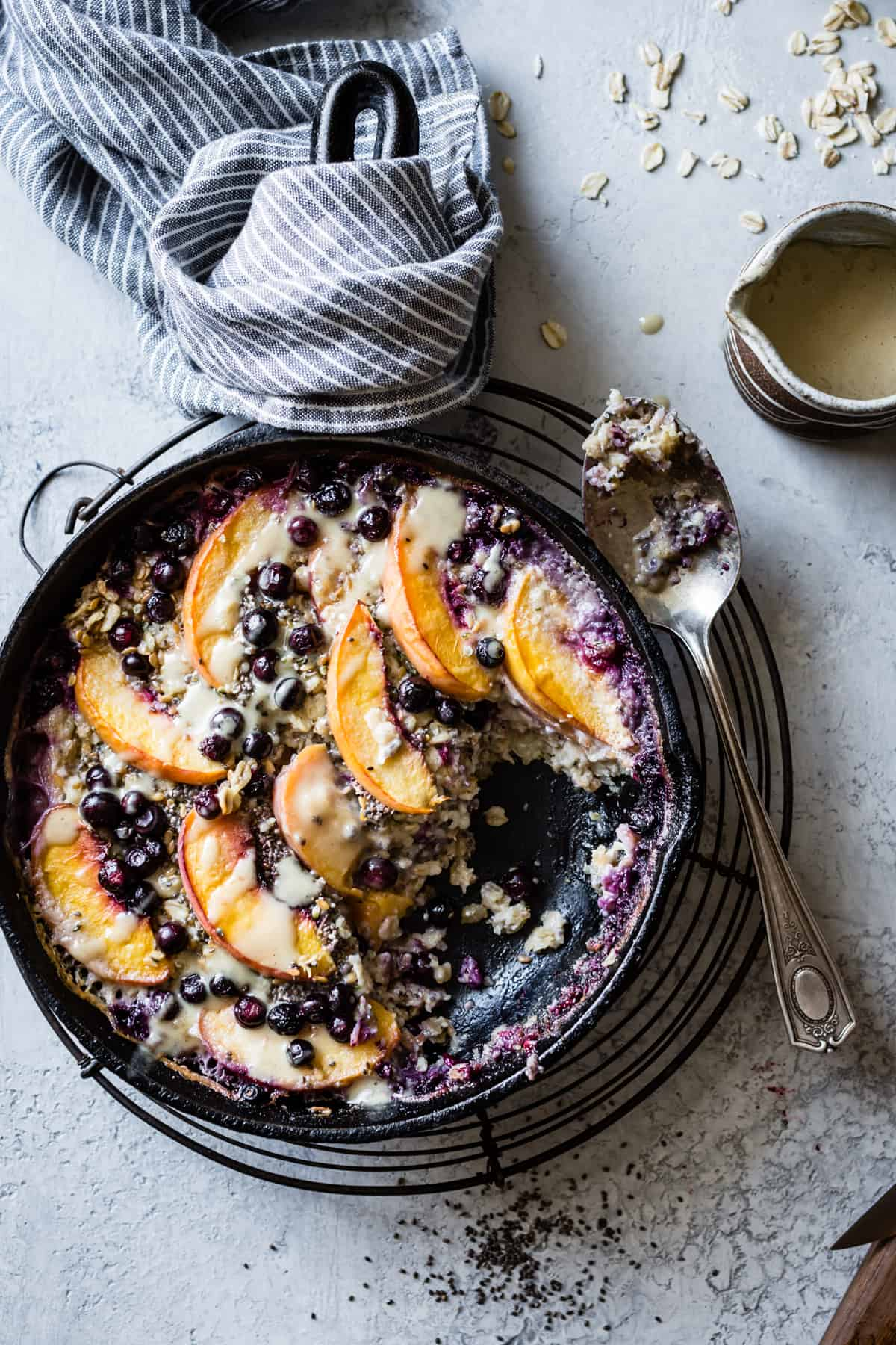 top down shot of lovely Super Seedy Vegan Baked Oatmeal with Peaches and Huckleberries {gluten-free & dairy-free}
