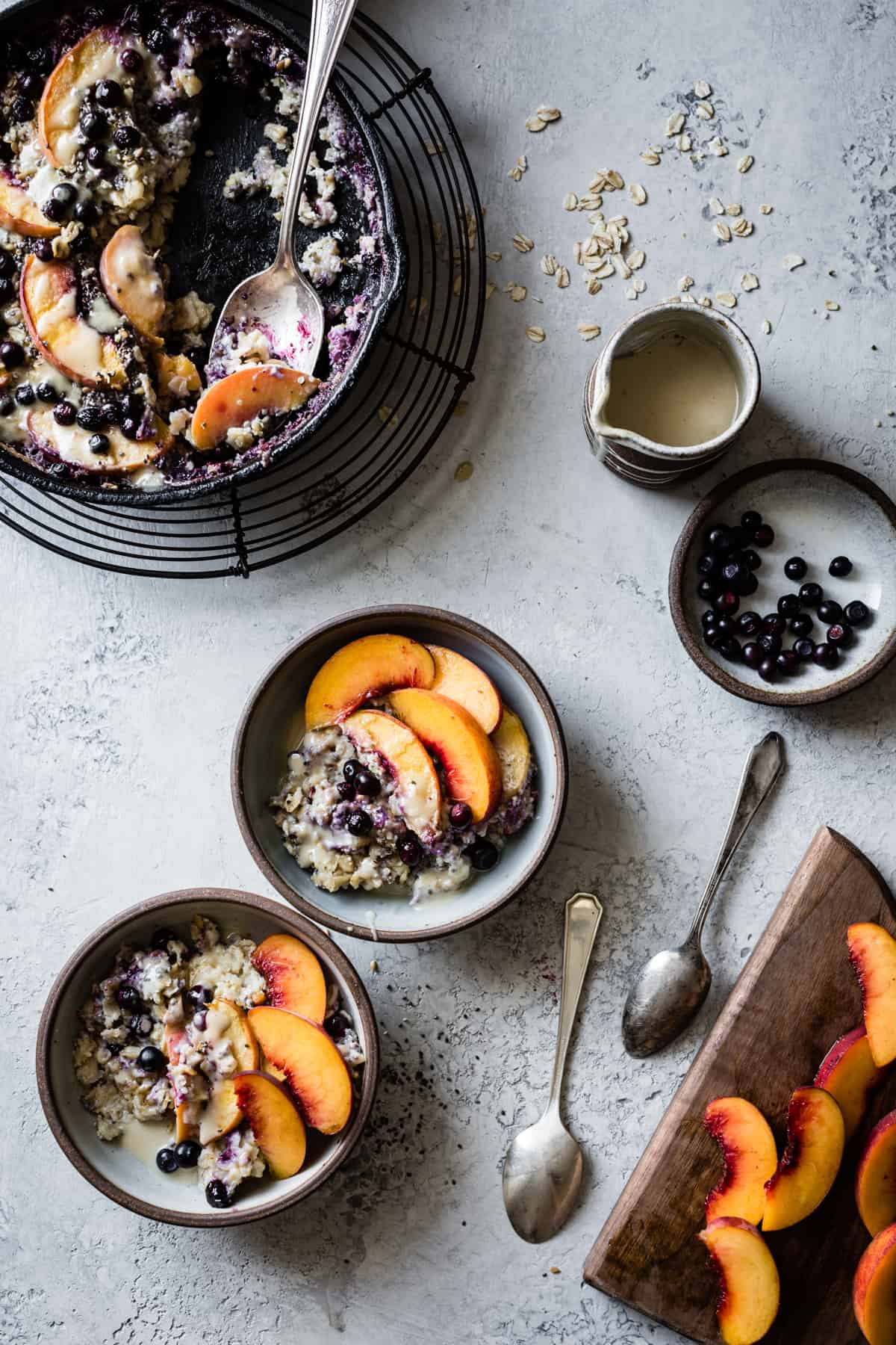 three bowls of Super Seedy Vegan Baked Oatmeal with Peaches and Huckleberries {gluten-free & dairy-free}