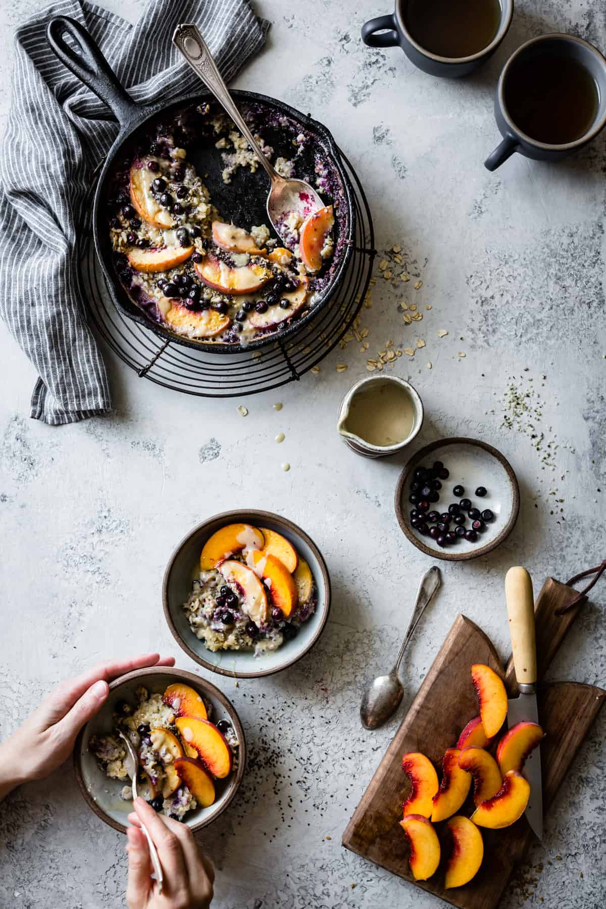 bowls of Super Seedy Vegan Baked Oatmeal with Peaches and Huckleberries {gluten-free & dairy-free}