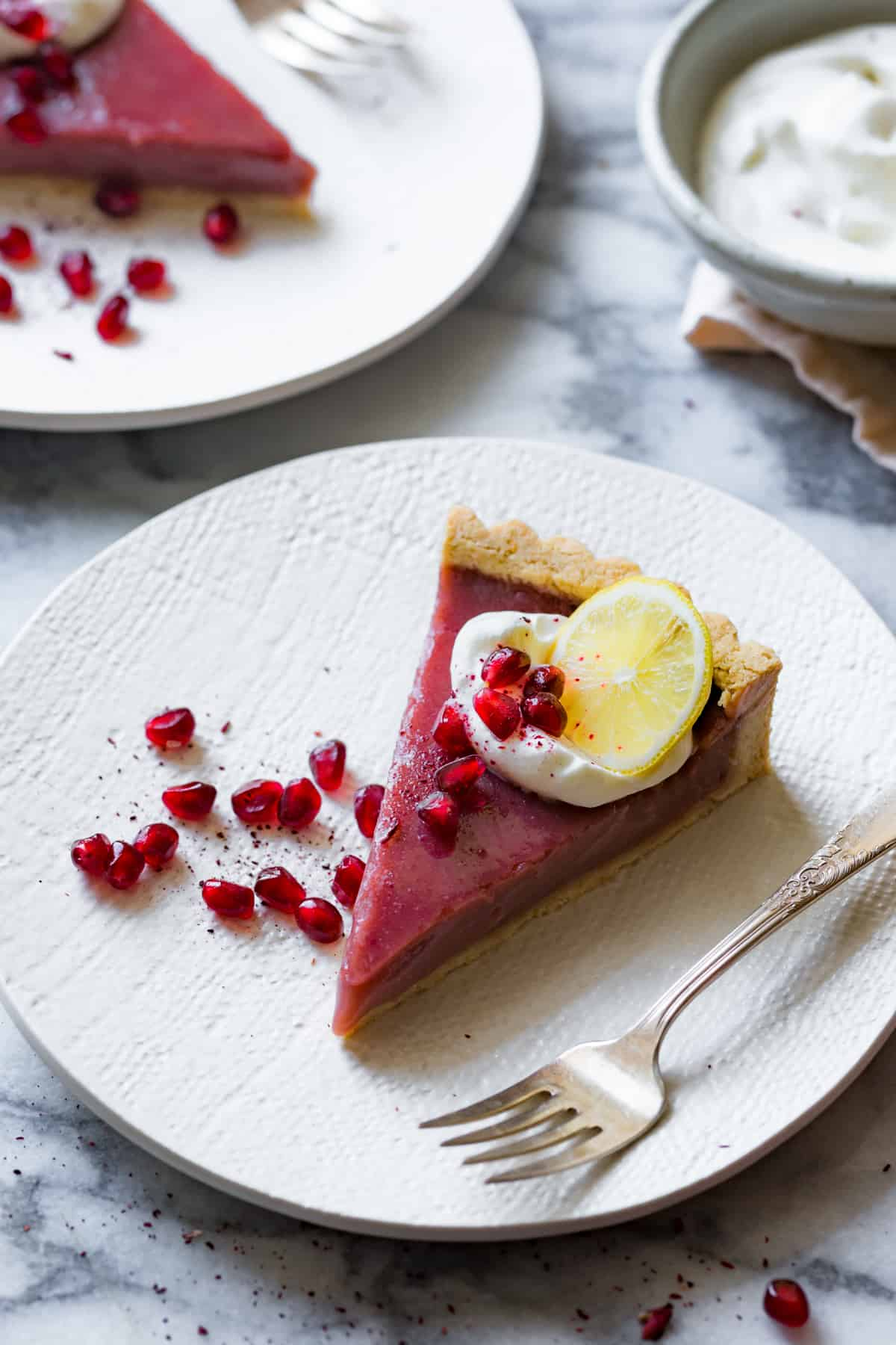 close up of Pomegranate Tart with Hibiscus, Lemon, and Almond Flour Crust {gluten-free}