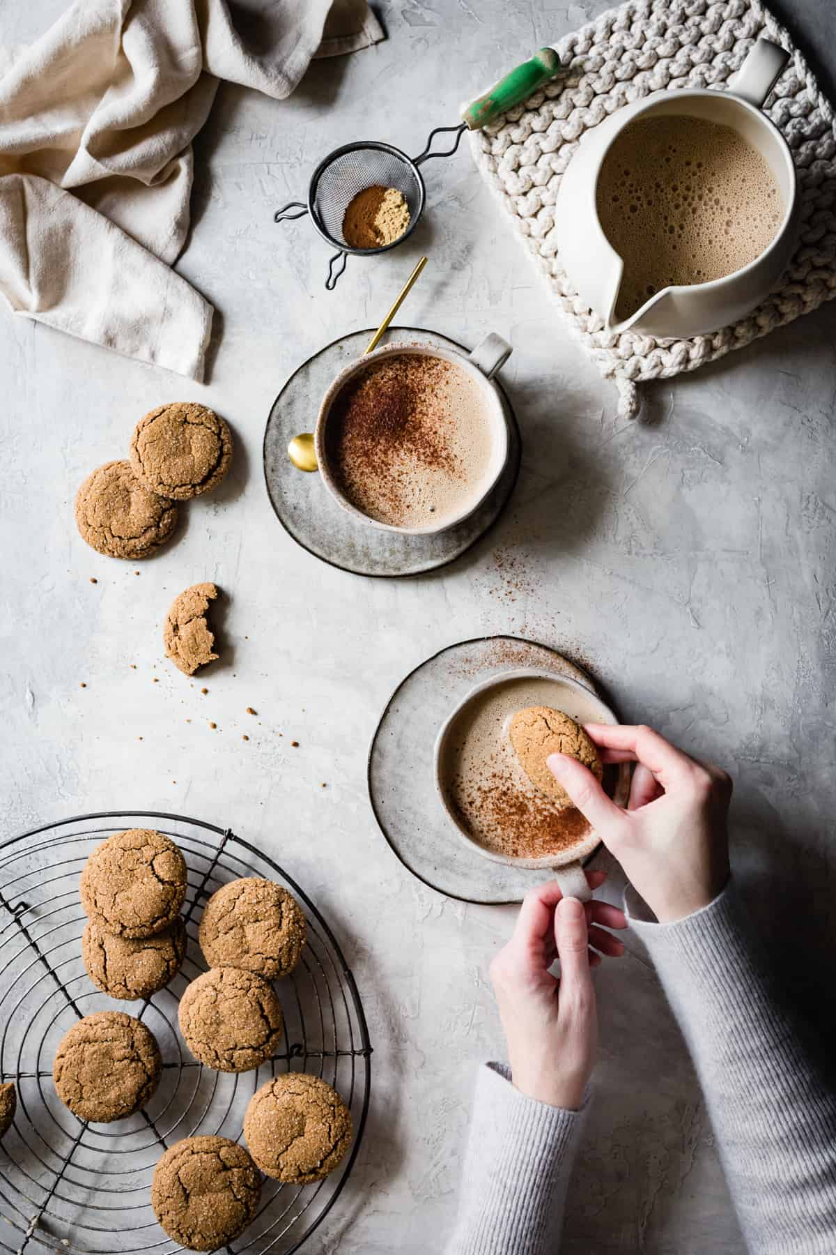 Gluten-Free Ginger Molasses Cookies on a table with gingersnap lattes