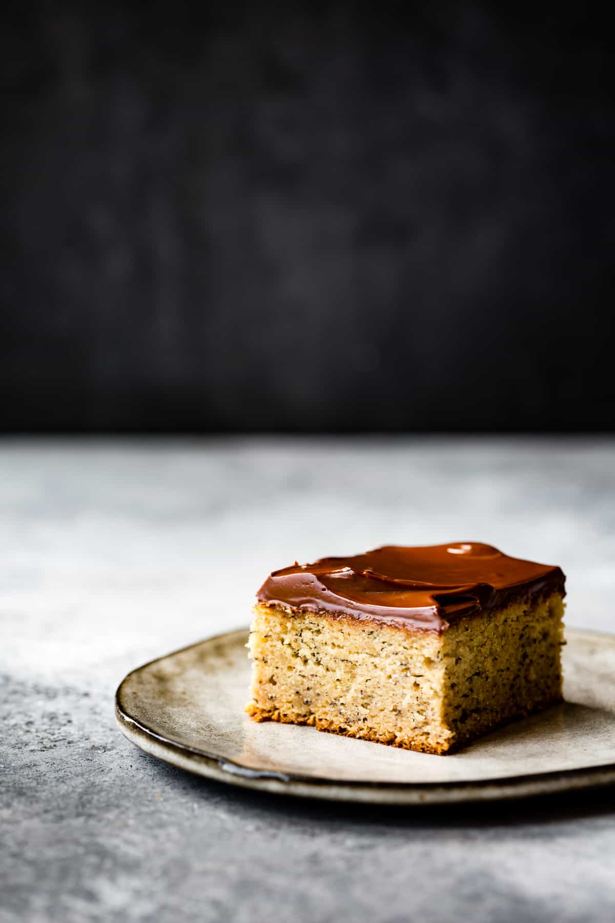 a square of Coconut Flour Banana Cake with Chocolate Rum Ganache {gluten-free, dairy-free}