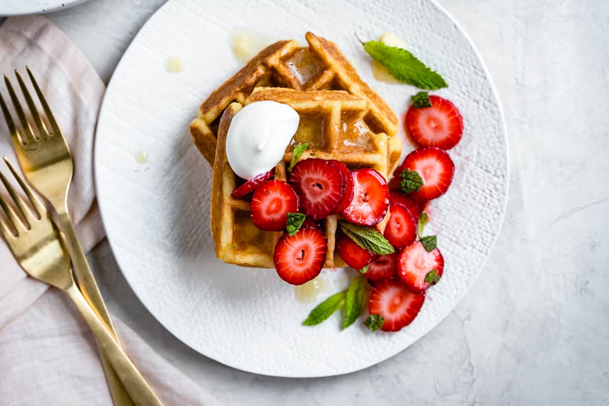 Corn Flour Waffles with Whipped Honey Ghee and strawberries {gluten-free}
