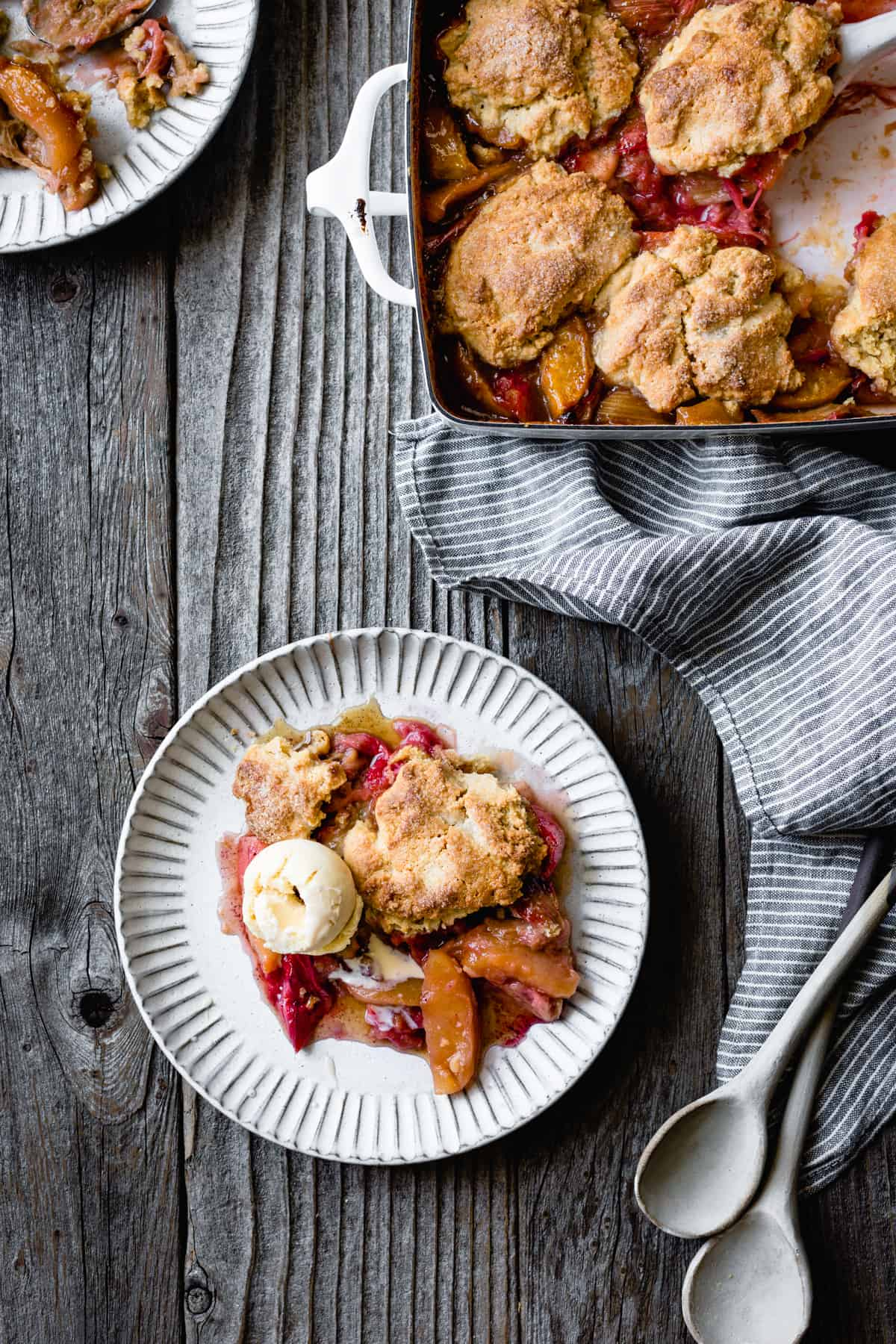plate and pan of Gluten Free Apple Cobbler with Maple & Rhubarb