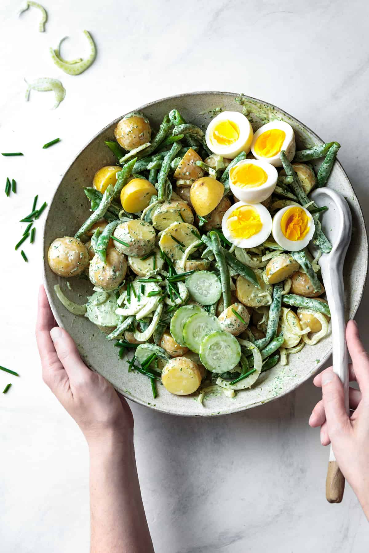 mixing Green Goddess Potato Salad