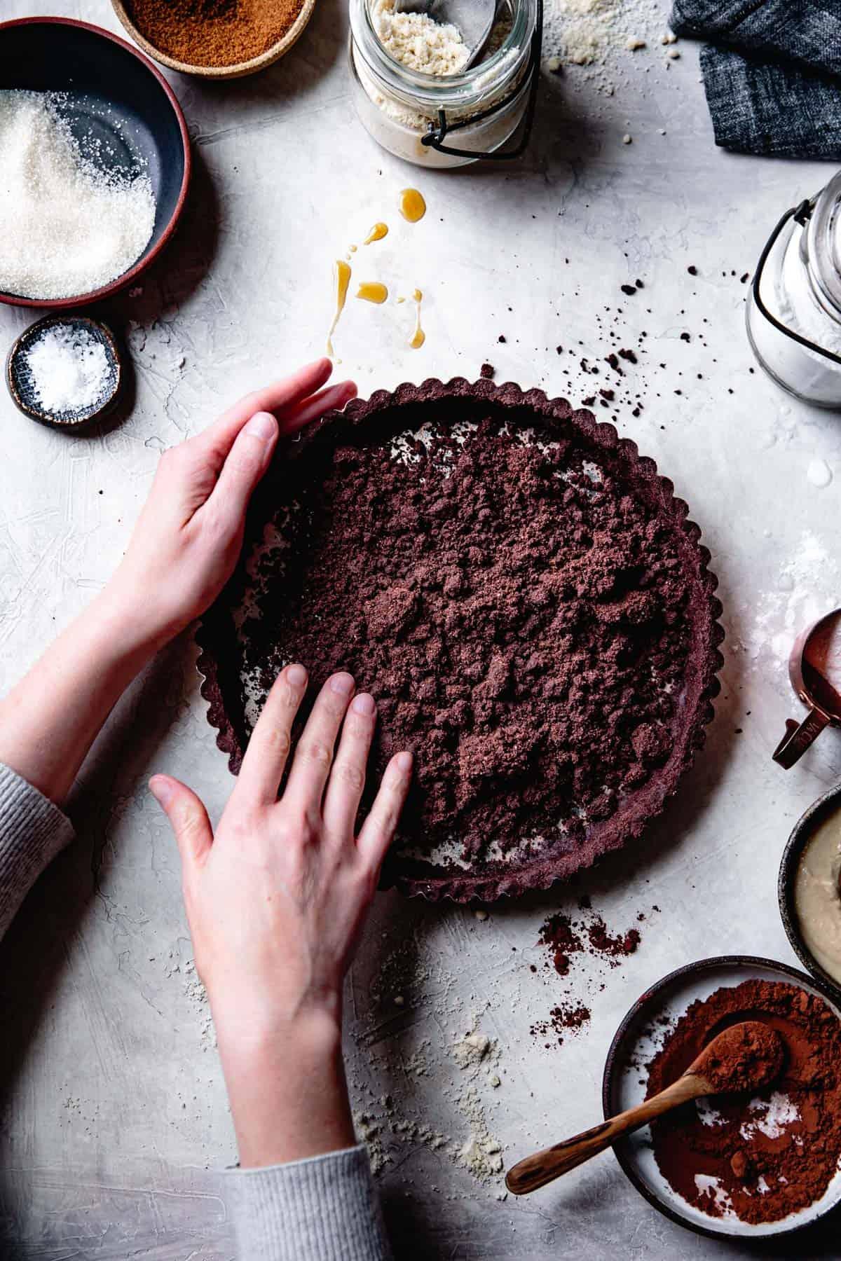 pressing down Gluten Free Vegan Almond Flour Tart Crust
